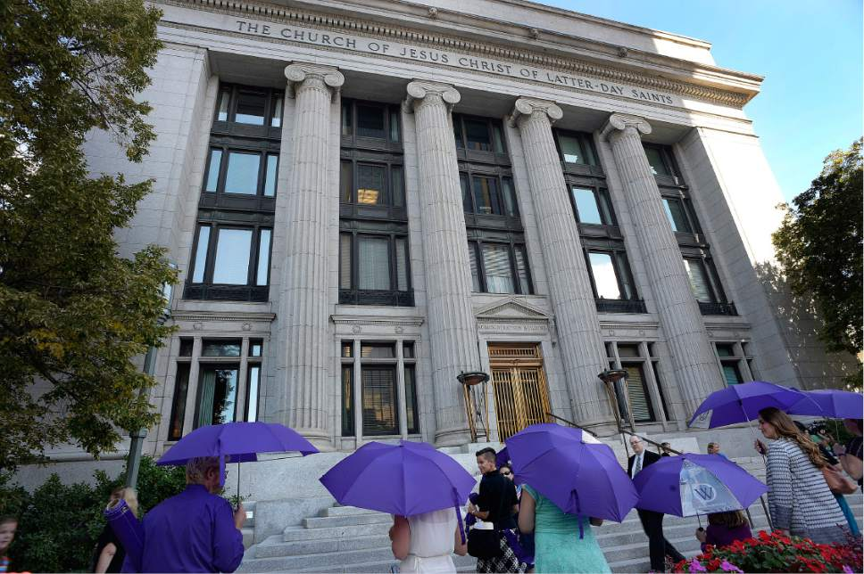 Scott Sommerdorf   |  The Salt Lake Tribune   Members of Ordain Women, carrying purple umbrellas, stand outside the LDS Church Administration Building to request a meeting with a general authority, Saturday, October 1, 2016.