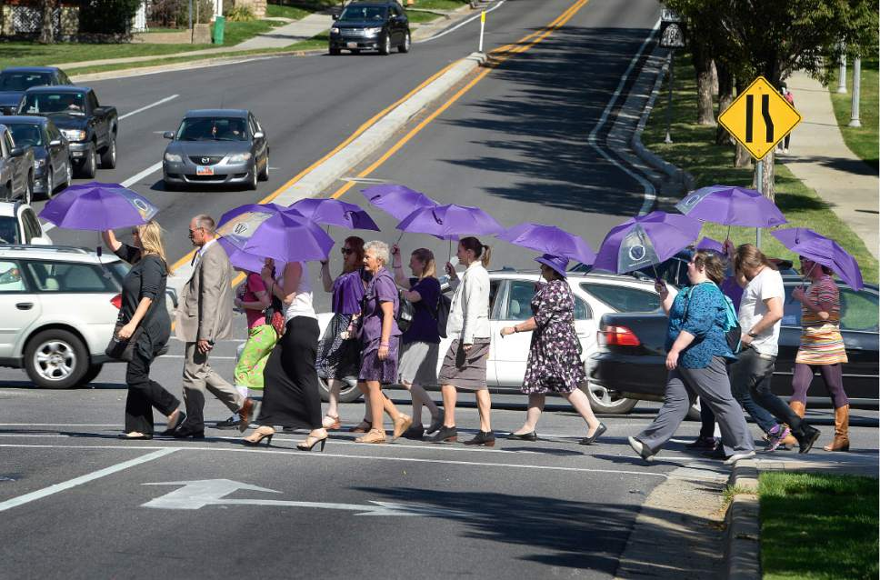 Scott Sommerdorf   |  The Salt Lake Tribune   Members of Ordain Women, carrying purple umbrellas, march to the LDS Church Administration Building to request a meeting with a general authority, Saturday, October 1, 2016.
