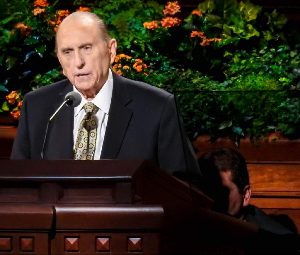 Trent Nelson  |  The Salt Lake Tribune President Thomas S. Monson, with an aide who helped him to the pulpit crouched behind him, speaks at the General Priesthood Session of the LDS Church's 186th Semiannual General Conference in Salt Lake City, Saturday October 1, 2016.