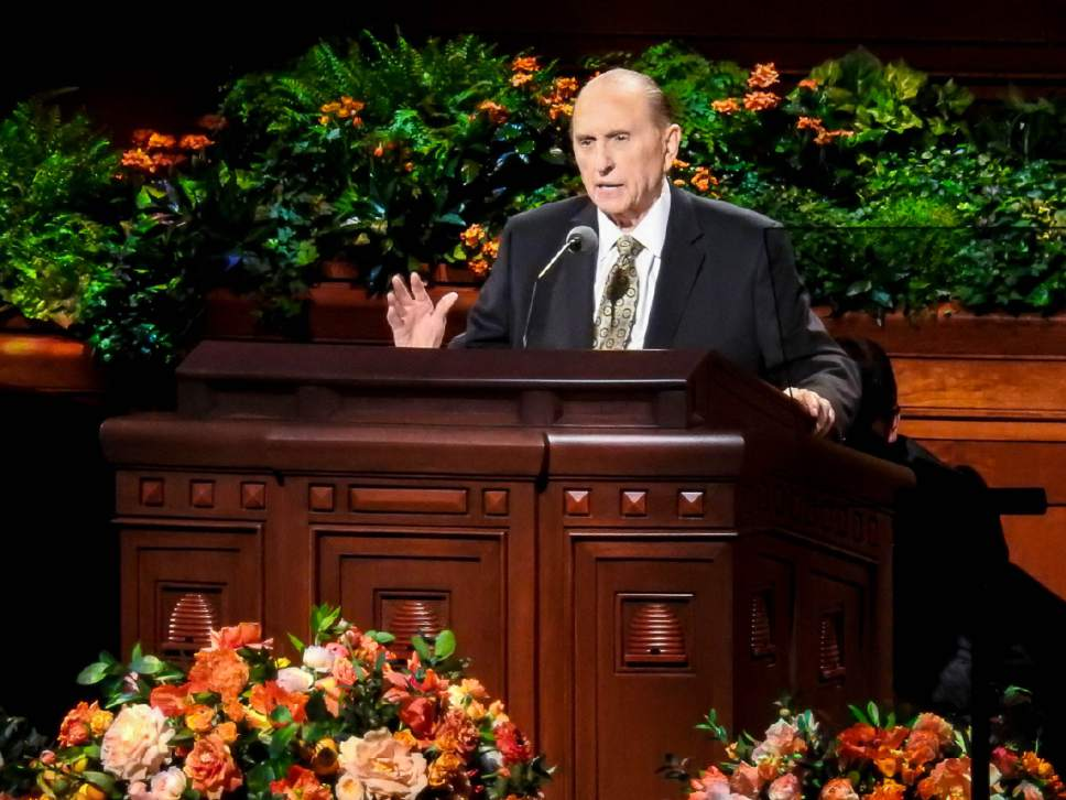 Trent Nelson  |  The Salt Lake Tribune President Thomas S. Monson, with the aide who helped him to the pulpit crouched behind him, speaks at the General Priesthood Session of the LDS Church's 186th Semiannual General Conference in Salt Lake City, Saturday October 1, 2016.
