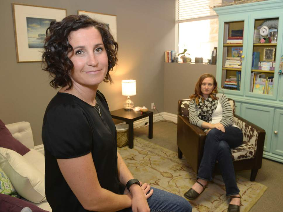 Al Hartmann  |   Tribune file photo Kristin Hodson, Founder, Executive Director, left, and Mary Stanley, Clinical Director, Art Therapist, run the Healing Group, a counseling center that focuses on sexuality and intimacy as well as postpartum depression.