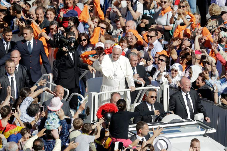 "Pope Francis leaves after celebrating a Mass to canonize seven new saints, in St. Peter's Square, at the Vatican, Sunday, Oct. 16, 2016. Among the new saints, Pope Francis is canonizing Argentine 19th century ""gaucho priest"" José Gabriel del Rosario Brochero, who ministered to the poor in the peripheries and is clearly a model for his papacy. (AP Photo/Andrew Medichini)"