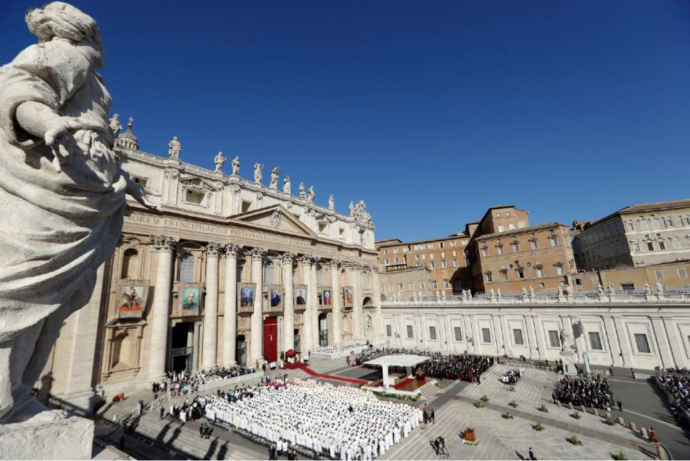 "People gather in St.Peter's Square to attend a Mass by Pope Francis to canonize seven new saints, in St. Peter's Square, at the Vatican, Sunday, Oct. 16, 2016. Among the new saints, Pope Francis is canonizing Argentine 19th century ""gaucho priest"" José Gabriel del Rosario Brochero, who ministered to the poor in the peripheries and is clearly a model for his papacy. (AP Photo/Andrew Medichini)"