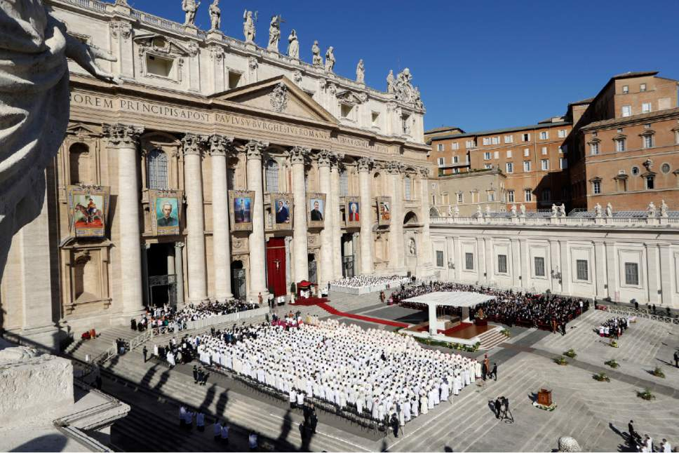 "The tapestries of seven new saints hang from the facade of St. Peter's Basilica during a Canonization Mass by Pope Francis, in St. Peter's Square, at the Vatican, Sunday, Oct. 16, 2016. Among the new saints, Pope Francis is canonizing Argentine 19th century ""gaucho priest"" José Gabriel del Rosario Brochero, who ministered to the poor in the peripheries and is clearly a model for his papacy. (AP Photo/Andrew Medichini)"