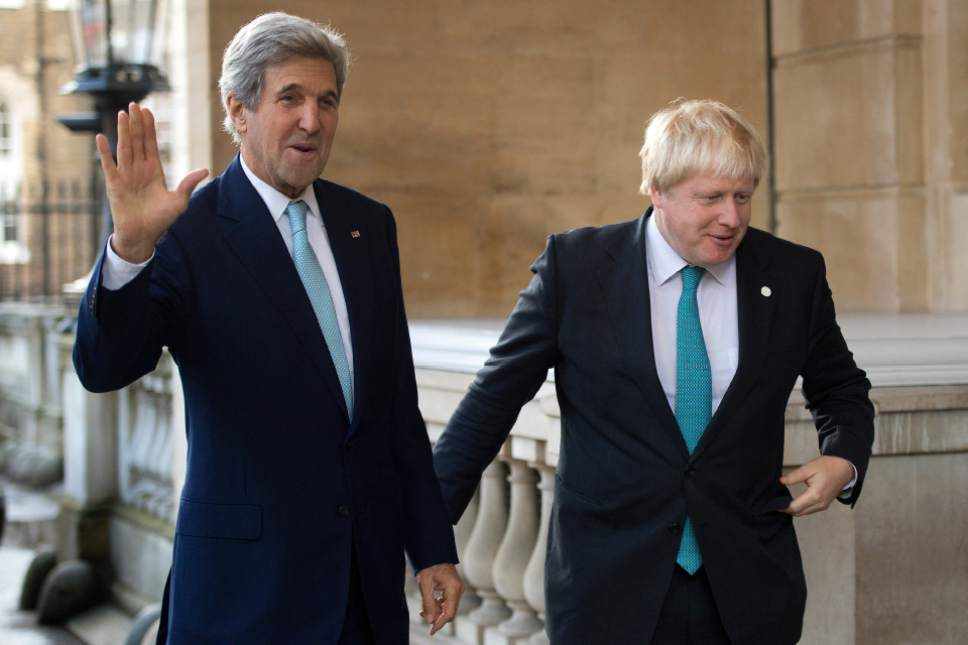 US Secretary of State John Kerry, left, waves as he is greeted by British Foreign Secretary Boris Johnson ahead of a meeting on the situation in Syria,  at Lancaster House in London, Sunday Oct. 16, 2016.  Renewing the international effort to solve the conflict in Syria, heightened by the plight of people in the city of Aleppo, have made little progress but more talks are planned. ( JUSTIN TALLIS / Pool via AP)