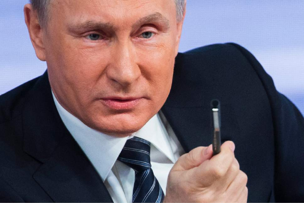 Russian President Vladimir Putin speaks during his annual end of year news conference in Moscow, Russia, Thursday, Dec. 17, 2015. Putin says that Russia's economy is showing signs of stabilization despite plummeting oil prices. Putin, speaking Thursday at a news conference televised live, said that despite a GDP drop caused by a drop in global oil prices, Russia's main commodity, the nation's industries have started to rebound. (AP Photo/Alexander Zemlianichenko)