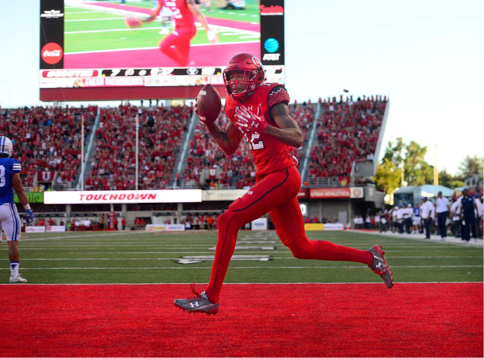 Scott Sommerdorf   |  The Salt Lake Tribune   Utah WR Tim Patrick runs through the end zone after his TD catch to give the Utes the lead back prior to the half. Utah led BYU 14-13 at the half, Saturday, September 10, 2016.