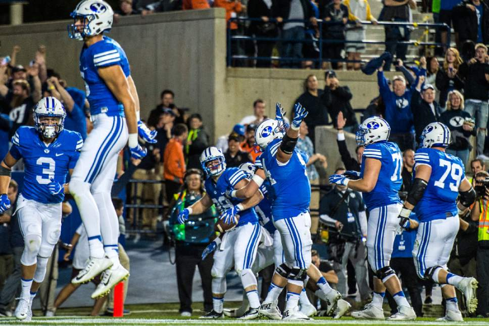 Chris Detrick  |  The Salt Lake Tribune Brigham Young Cougars tight end Tanner Balderree (89) celebrates with his teammates after scoring the game-winning touchdown during the game at LaVell Edwards Stadium Saturday October 15, 2016. Brigham Young Cougars defeated Mississippi State Bulldogs 28-21in double overtime.
