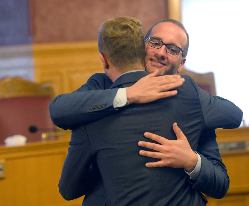 Al Hartmann  |  The Salt Lake Tribune  Troy Williams with Equality Utah, left, and Chad Griffin, President of Human Rights Campaign hug after a press conference reporting results of the city's score on LGBT issues at the City-County Building Monday October 17.  It showed Salt Lake City earning a better than average score among U.S. cities when judged on its policies and practices of including lesbian, gay, bisexual, transgender and queer citizens.  Behind him are Troy Williams, left, and Bruce Bastian with Equality Utah.  The survey conducted by the Human Rights Campaign, the Metropolitan Equality Index is the only national assessment of LGGBTQ inclusion in municipal law and policy.  A record 506 cities were evaluated for the report, with 60 cities earning a perfect score of 100. Salt Lake City earned the highest ranking -- 69 -- among the eight Utah cities included in the survey.