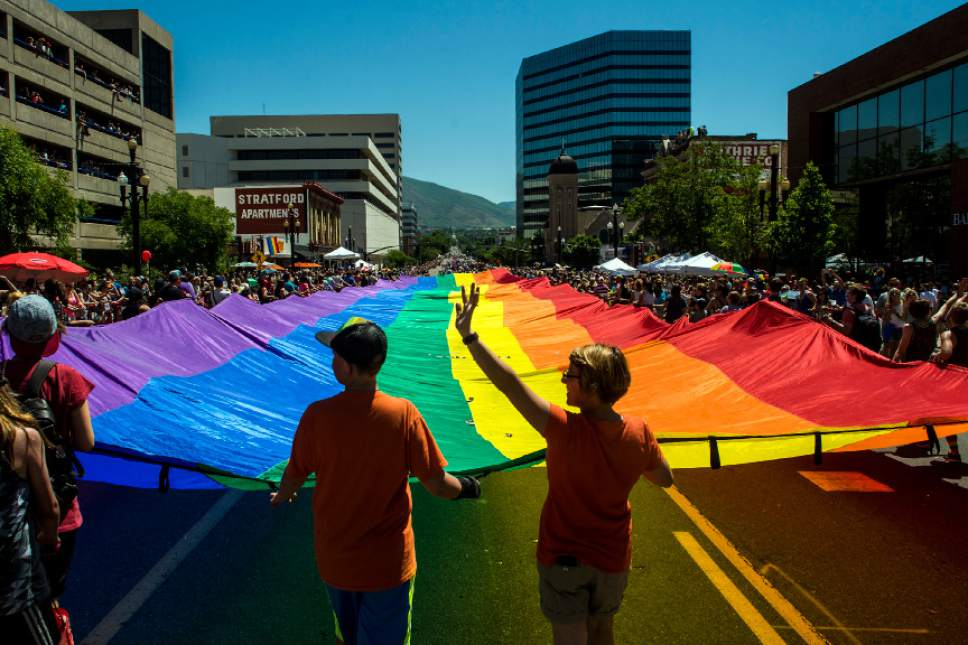 Chris Detrick  |  The Salt Lake Tribune Participants carry a giant Rainbow Flag during the Utah Pride Parade Sunday June 5, 2016.