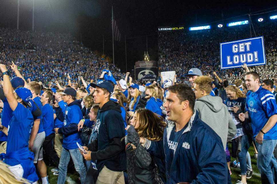 Chris Detrick  |  The Salt Lake Tribune Brigham Young Cougar fans celebrate after the game at LaVell Edwards Stadium Saturday October 15, 2016. Brigham Young Cougars defeated Mississippi State Bulldogs 28-21in double overtime.
