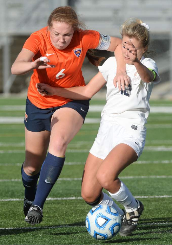 Steve Griffin / The Salt Lake Tribune   Timpview's Abby Woodfield, left,  powers past Skyline's Natalie Winward during 4A semifinal soccer match between at Juan Diego Catholic High School in Draper Tuesday October 18, 2016.