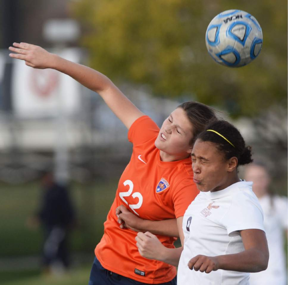 Steve Griffin / The Salt Lake Tribune   Timpview's Kathryn Winn and Skyline's Bergen Meyer crash together as they try to head the ball during 4A semifinal soccer match at Juan Diego Catholic High School in Draper Tuesday October 18, 2016.