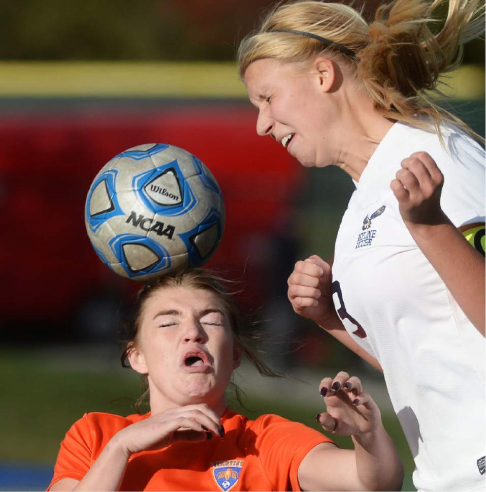 Steve Griffin / The Salt Lake Tribune   Timpview's Dakota Smith heads the ball away from Skyline's Madelyn Gill during 4A semifinal soccer match at Juan Diego Catholic High School in Draper Tuesday October 18, 2016.