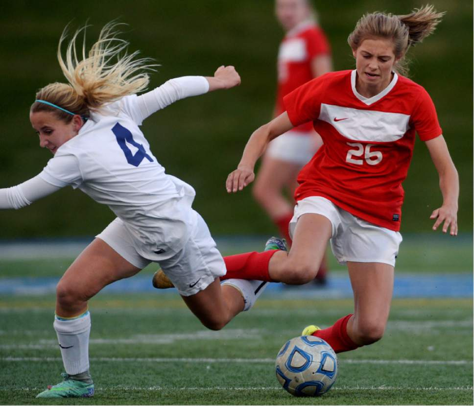 Steve Griffin / The Salt Lake Tribune   Woods Cross forward Camryn Henson, left, and East's Erin Bridges get their legs tangled up during 4A semifinal soccer match at Juan Diego Catholic High School in Draper Tuesday October 18, 2016.