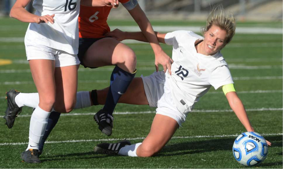 Steve Griffin / The Salt Lake Tribune   Skyline's Natalie Winward crashes to the ground during 4A semifinal soccer match between at Juan Diego Catholic High School in Draper Tuesday October 18, 2016.