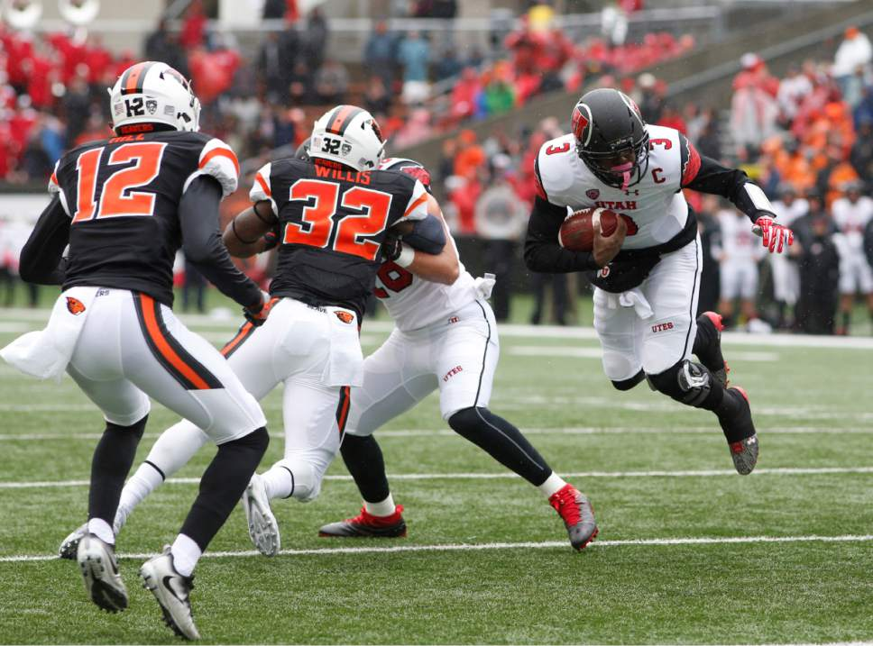 Utah quarterback Troy Williams (3) is tripped up as Oregon State's Kendal Hill (12) and Jonathan Willis (32) close in during the first half of an NCAA college football game in Corvallis, Ore., on Saturday, Oct. 15, 2016. (AP Photo/Timothy J. Gonzalez)