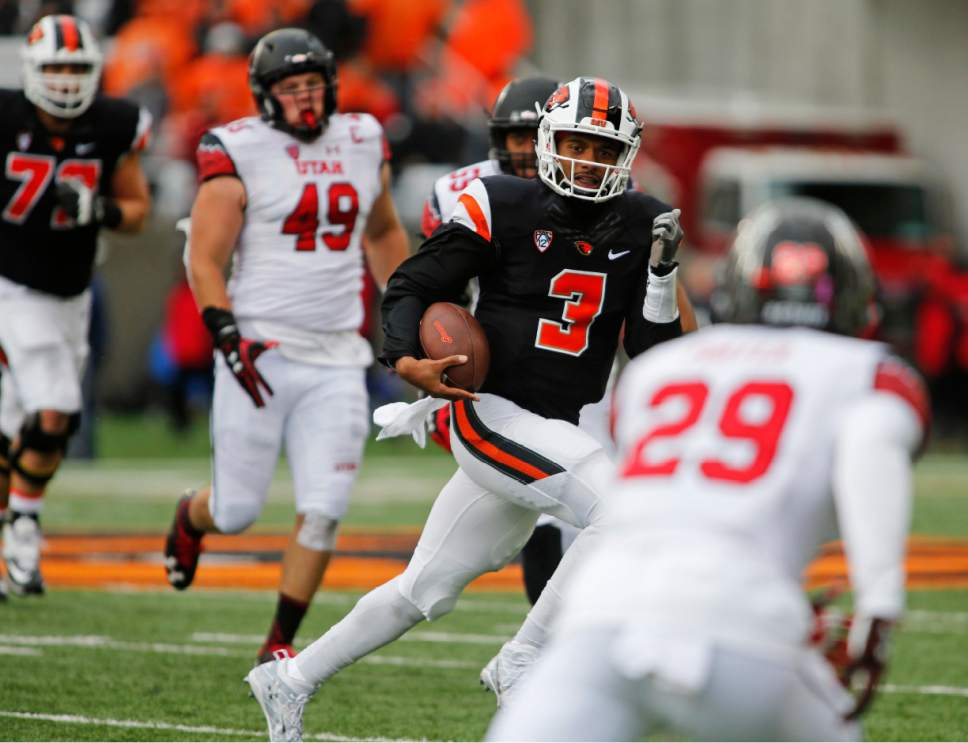 Oregon State quarterback Marcus McMaryion (3) makes his way through the Utah defense in the second half of an NCAA college football game in Corvallis, Ore., on Saturday, Oct. 15, 2016. Utah won 19-14. (AP Photo/Timothy J. Gonzalez)