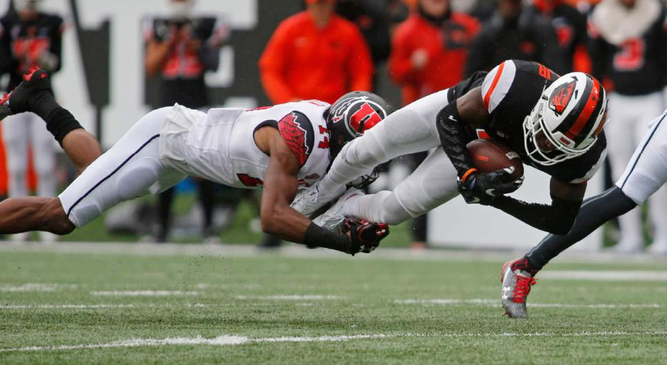 Oregon State wide receiver Victor Bolden Jr., right, is tackled by Utah cornerback Brian Allen in the second half of an NCAA college football game in Corvallis, Ore., on Saturday, Oct. 15, 2016. Utah won 19-14. (AP Photo/Timothy J. Gonzalez)