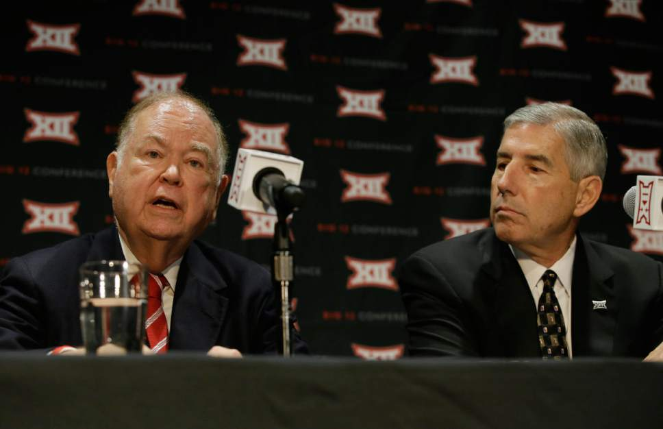 Oklahoma President David Boren, left, speaks as Big 12 Commissioner Bob Bowlsby looks on during a news conference after The Big 12 Conference meeting in Grapevine, Texas, Monday, Oct. 17, 2016. The Big 12 Conference has decided against expansion from its current 10 schools after three months of analyzing, vetting and interviewing possible new members. (AP Photo/LM Otero)