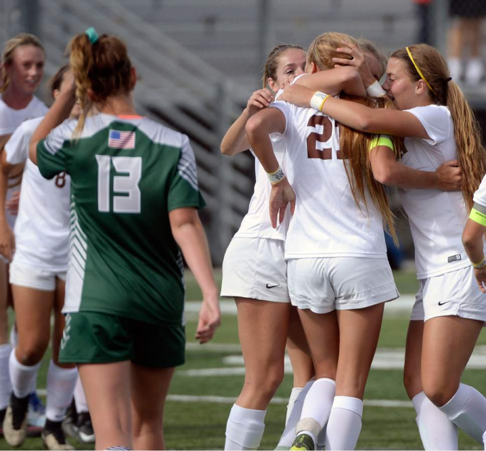 Al Hartmann  |  The Salt Lake Tribune Davis High School players celebrate Mikayla Colohan's goal against Copper Hills High School in 5A semifinal Girl's Soccer match Tuesday Oct. 18.