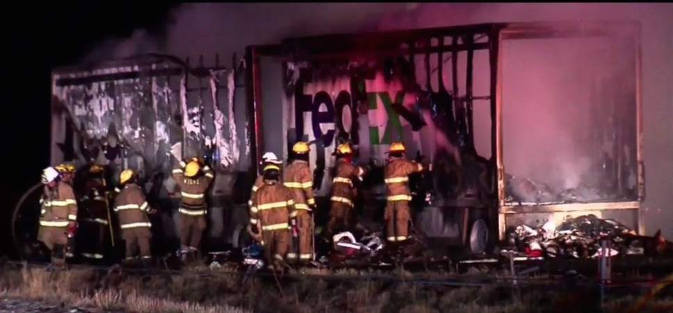 Courtesy of KUTV News  A FedEx truck burned after colliding with another semi's lose load on I-80 early Wednesday morning.