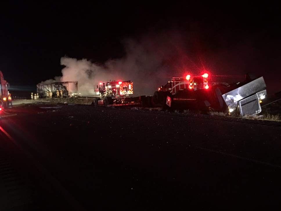 Courtesy of KUTV News  Two drivers were dead and I-80 closed down in both directions west of Salt Lake City early Wednesday after semis collided.