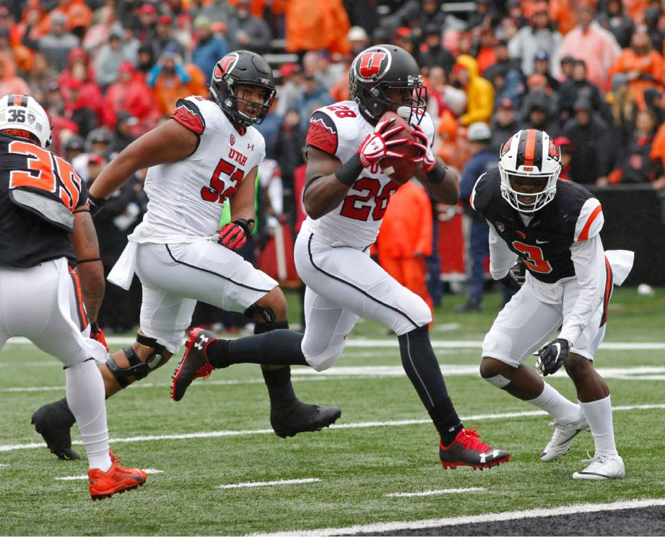 Utah running back Joe Williams hops into the end zone for a touchdown in the first half of an NCAA college football game against Oregon State, in Corvallis, Ore., on Saturday, Oct. 15, 2016. (AP Photo/Timothy J. Gonzalez)