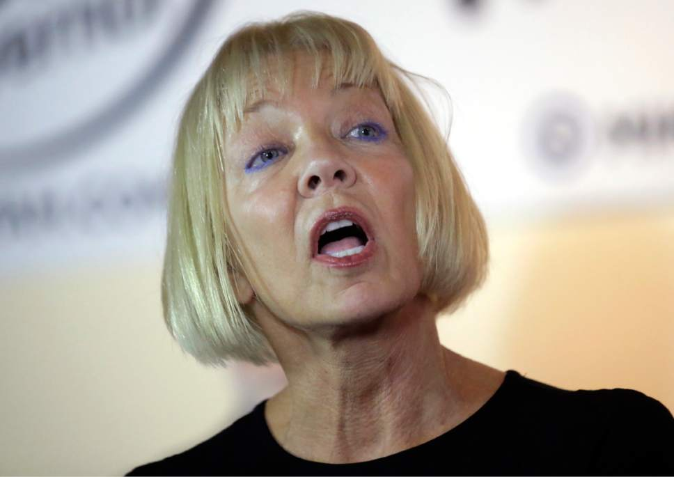 Donna Weinholtz, the wife of Utah's Democratic candidate for governor, Mike Weinholtz, speaks during a news conference Tuesday, Oct. 18, 2016, in Salt Lake City. Hours after his wife pleaded guilty to misdemeanor pot-possession charges connected with two pounds of the drug found at their house, Mike Weinholtz pushed Tuesday for the legalization of medical marijuana. (AP Photo/Rick Bowmer)