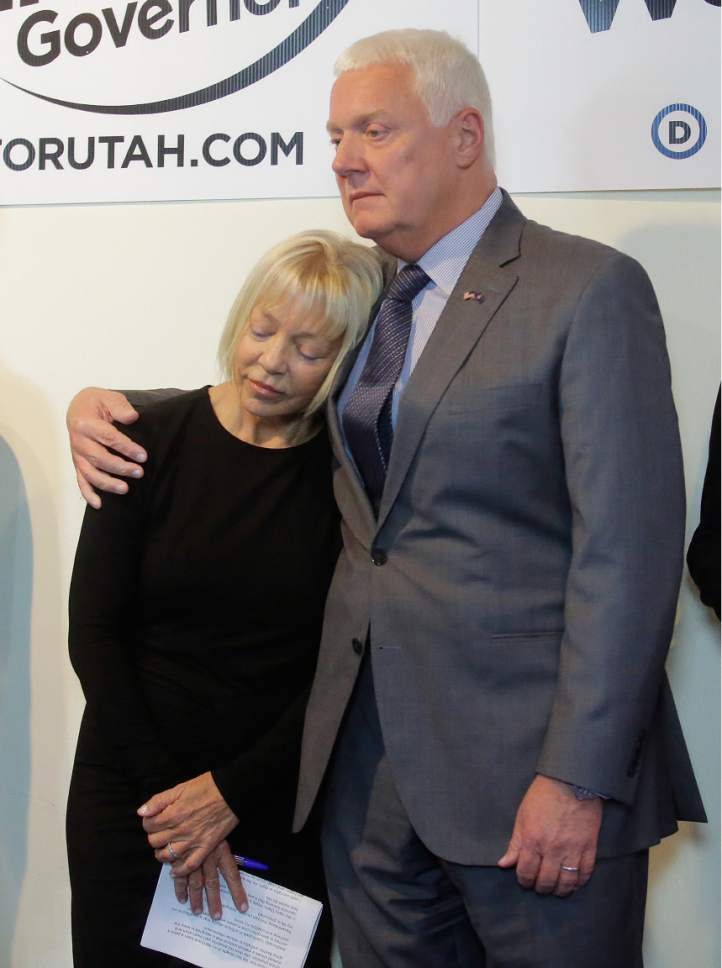 Utah's Democratic candidate for governor, Mike Weinholtz hugs his wife Donna Weinholtz after she spoke at a news conference Tuesday, Oct. 18, 2016, in Salt Lake City. Hours after his wife pleaded guilty to misdemeanor pot-possession charges connected with two pounds of the drug found at their house, Mike Weinholtz pushed Tuesday for the legalization of medical marijuana. (AP Photo/Rick Bowmer)