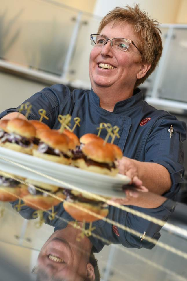 Francisco Kjolseth  |  The Salt Lake Tribune Executive chef Stacey Rosati serves up an order of sliders during a recent preview of Encore Bistro, located in the Grand Lobby of  the new George S. and Dolores DorÈ Eccles Theater in downtown Salt Lake City.