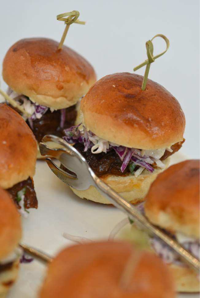 Francisco Kjolseth  |  The Salt Lake Tribune Encore Bistro's stage left sliders ($10.50, three per order): slow-braised beef, spicy BBQ sauce, toasted cumin and apple slaw.