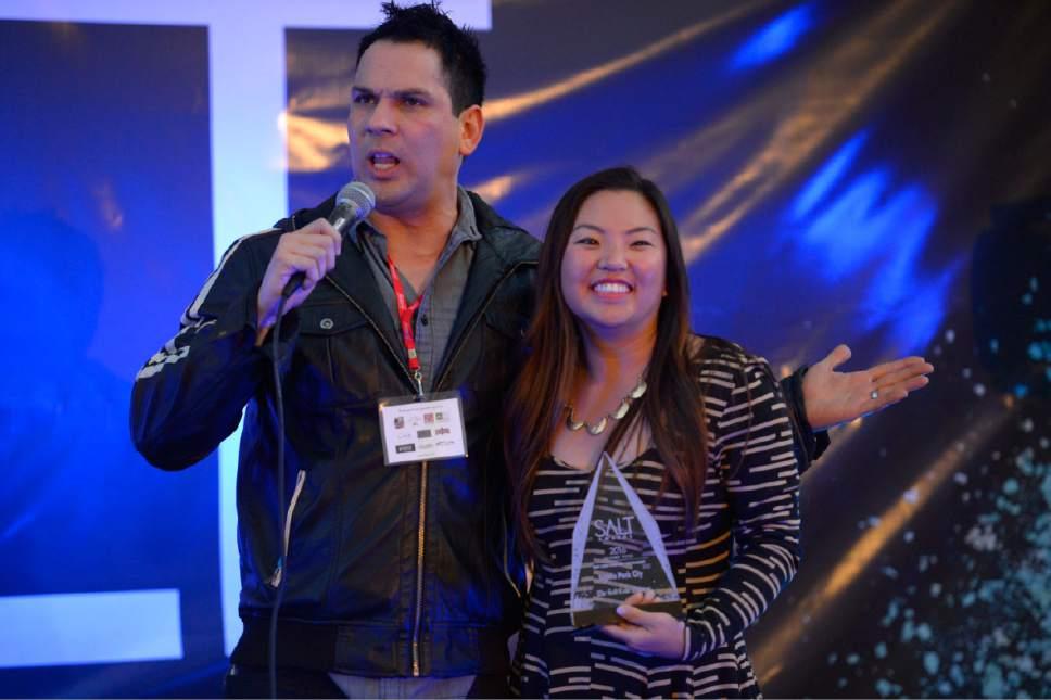 Trent Nelson  |  The Salt Lake Tribune Comedian and host Marcus Hardy with Maggie Alvarez, co-owner of Tupelo, the 2016 Salt Award winner for best new Park City restaurant. The 2016 Salt Awards ceremony was held at The Gateway in Salt Lake City, Wednesday October 12, 2016.