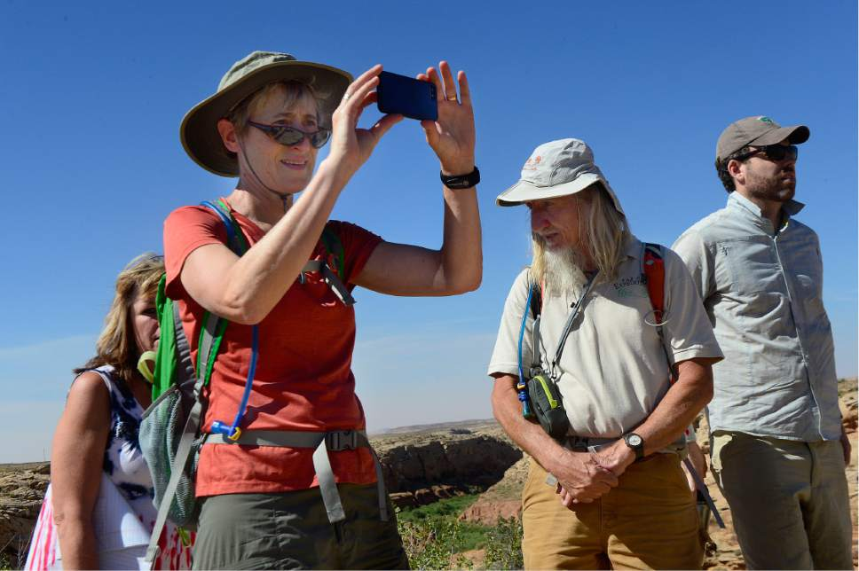 Scott Sommerdorf   |  The Salt Lake Tribune   U.S. Interior Secretary Sally Jewell makes a photo on top of the peak overlooking Comb Ridge. Second from the right is Vaughn Hadenfeldt of Friends of Cedar Mesa, and at right is BLM Director Neil Kornze, Saturday, July 15, 2016.