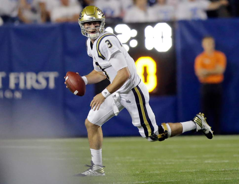 UCLA quarterback Josh Rosen (3) looks downfield before throwing again BYU in the first half during an NCAA college football game Saturday, Sept. 17, 2016, in Provo, Utah. (AP Photo/Rick Bowmer)