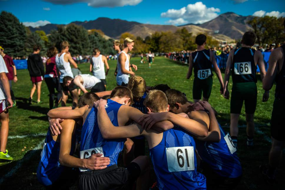 Chris Detrick  |  The Salt Lake Tribune Members of the Bingham High School team pray during the UHSAA State Cross Country Championships at Sugar House Park Wednesday October 19, 2016.