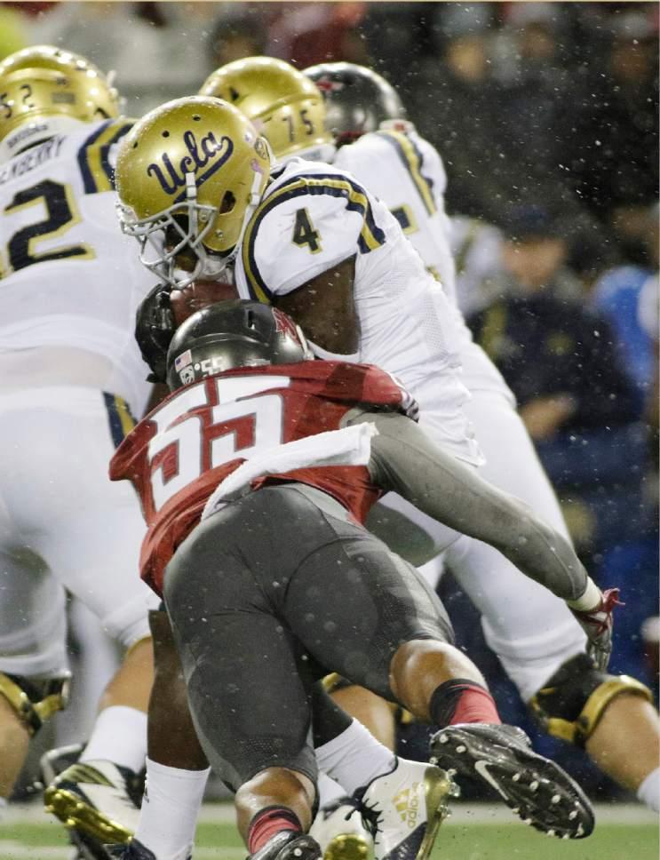 Washington State linebacker Derek Moore (55) brings down UCLA running back Bolu Olorunfunmi (4) during the first half of an NCAA college football game in Pullman, Wash., Saturday, Oct. 15, 2016. (AP Photo/Young Kwak)