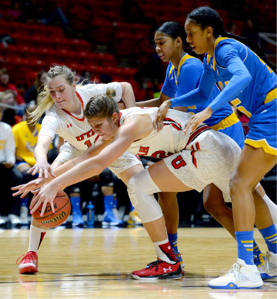 Steve Griffin  |  The Salt Lake Tribune   Utah Utes guard Paige Crozon (14) and Utah Utes forward Emily Potter (12) stretch for the ball in front of UCLA's Kelli Hayes and Monique Billings during women's basketball game at the Huntsman Center in Salt Lake City, Sunday, January 31, 2016.