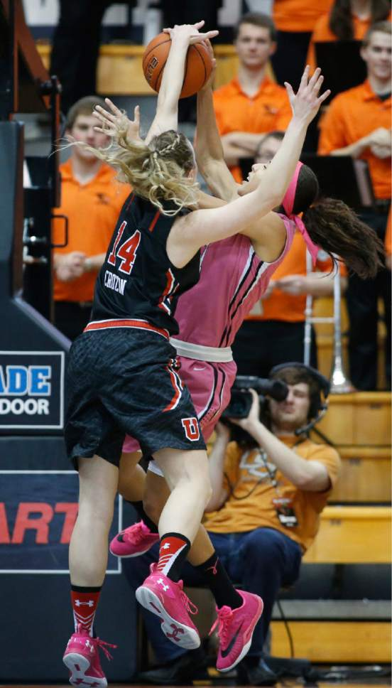 Utah's Paige Crozon, left, fouls Oregon State's Gabriella Hanson in the first half of an NCAA college basketball game in Corvallis, Ore., on Sunday, Feb. 14, 2016. (AP Photo/Timothy J. Gonzalez)