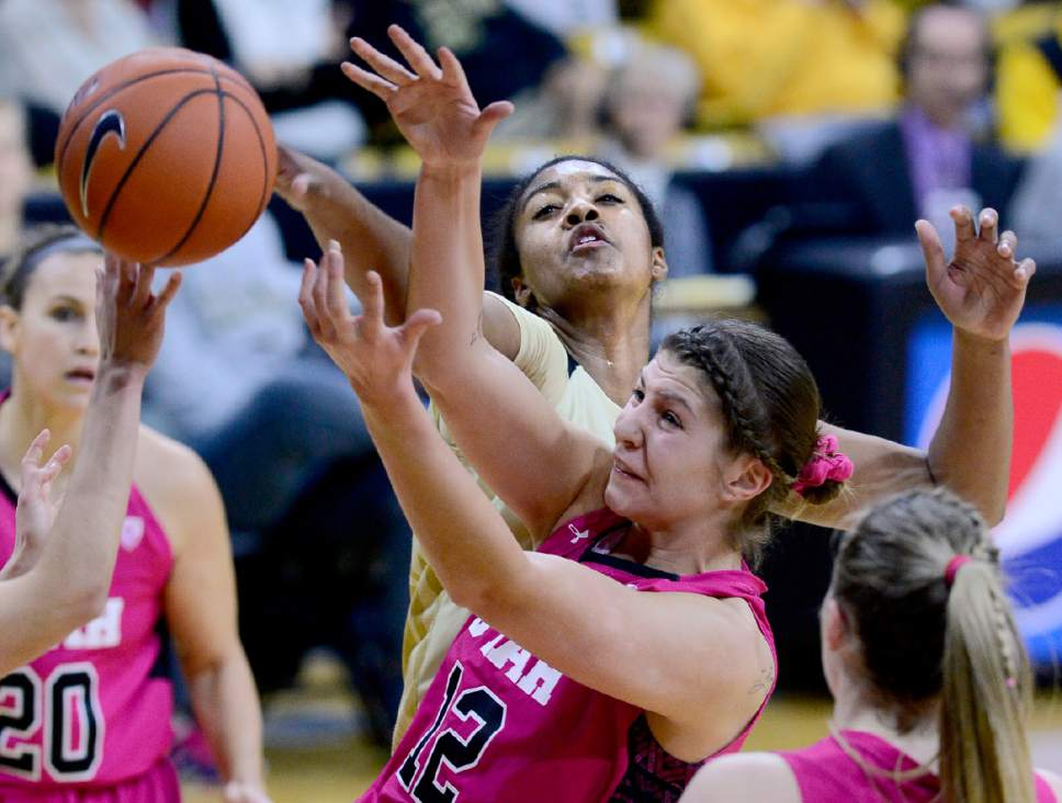Utah's Emily Potter (12) battles with Colorado's Zoe Correal during the first half of an NCAA college basketball game in Boulder, Colo., Sunday, Feb. 7, 2016. Utah won, 76-68. (Cliff Grassmick/Daily Camera via AP) MANDATORY CREDIT