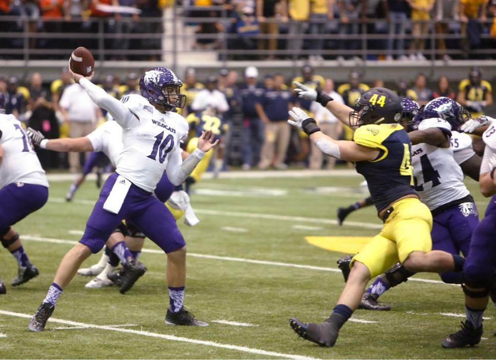 Weber State quarterback Jadrian Clark (10) throws a pass against Northern Arizona during an NCAA college football game in Flagstaff, Ariz., Saturday, Oct. 24, 2015. (Taylor Mahoney/Arizona Daily Sun via AP)
