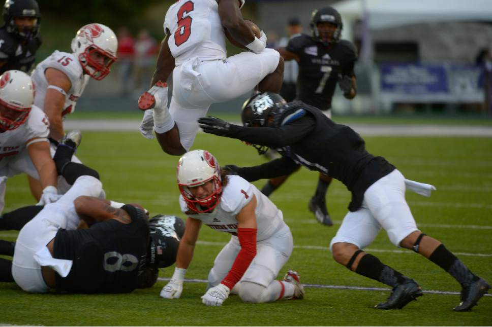 Leah Hogsten  |  The Salt Lake Tribune Southern Utah Thunderbirds running back Pete Williams (6) leaps over Weber State defense. Southern Utah University leads Weber State University 17-0, October 2, 2015 at Stewart Stadium in Ogden.