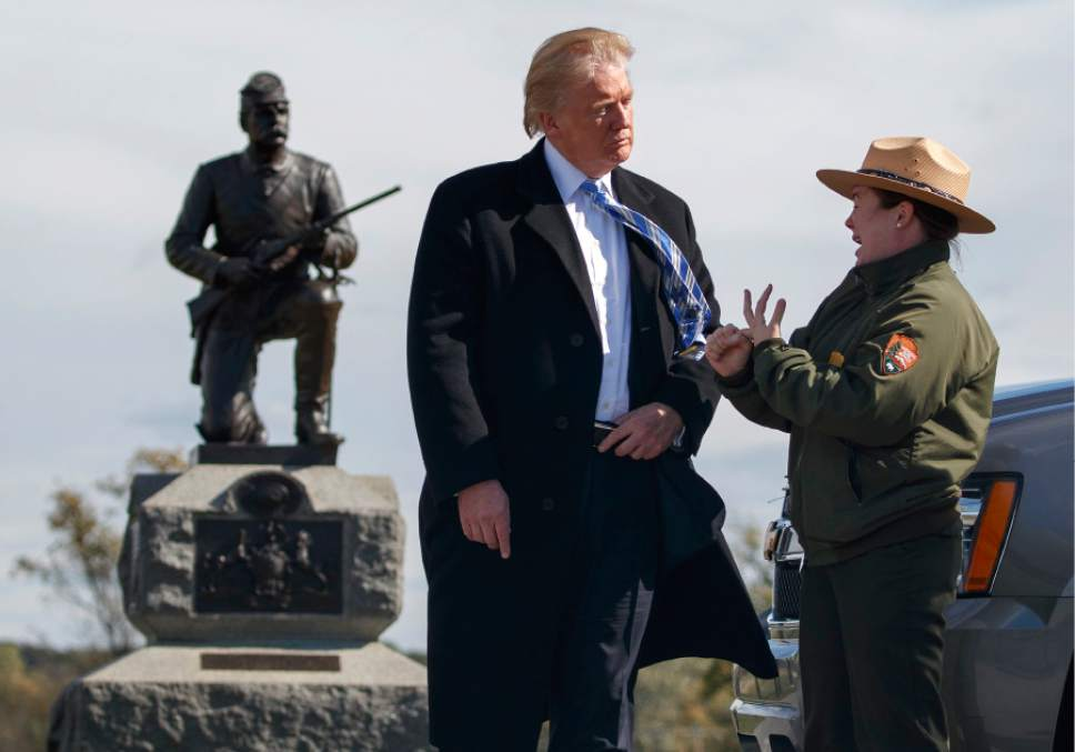 Interpretive park ranger Caitlin Kostic speaks to Republican presidential candidate Donald Trump as she gives him a tour at Gettysburg National Military Park Saturday, Oct. 22, 2016, in Gettysburg, Pa. (AP Photo/ Evan Vucci)