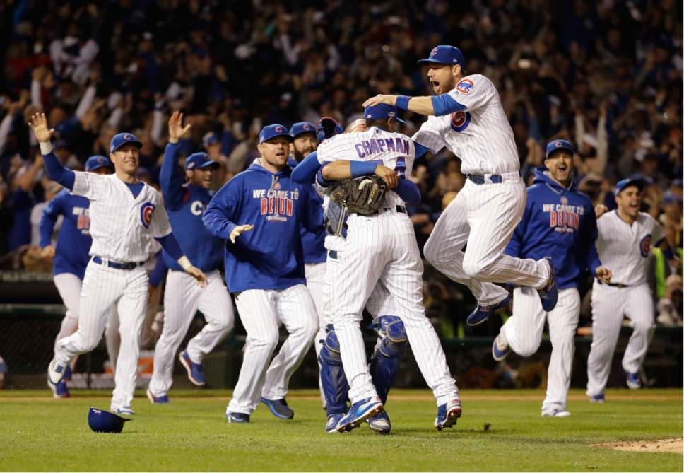 Chicago Cubs players celebrate after Game 6 of the National League baseball championship series against the Los Angeles Dodgers, Saturday, Oct. 22, 2016, in Chicago. The Cubs won 5-0 to win the series and advance to the World Series against the Cleveland Indians. (AP Photo/David J. Phillip)