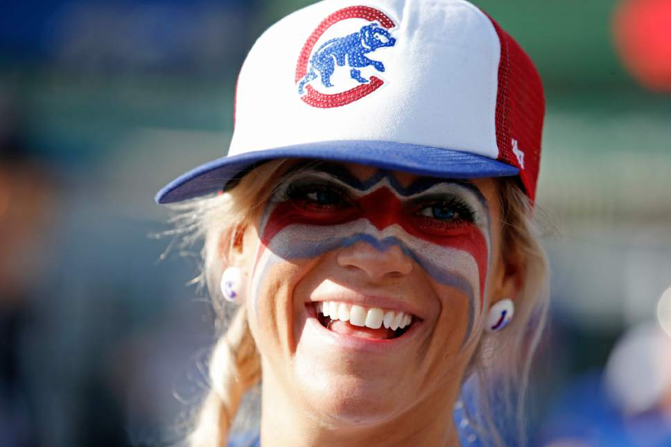 A Chicago Cubs fan arrives at Wrigley Field before Game 6 of the National League baseball championship series between the Chicago Cubs and the Los Angeles Dodgers, Saturday, Oct. 22, 2016, in Chicago. (AP Photo/Nam Y. Huh)