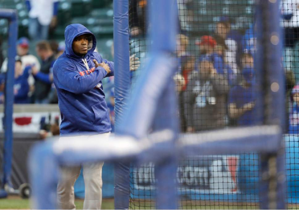 Los Angeles Dodgers right fielder Yasiel Puig warms up before Game 6 of the National League baseball championship series against the Chicago Cubs, Saturday, Oct. 22, 2016, in Chicago. (AP Photo/David J. Phillip)