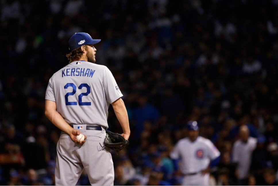 Los Angeles Dodgers starting pitcher Clayton Kershaw (22) throws during the third inning of Game 6 of the National League baseball championship series against the Chicago Cubs, Saturday, Oct. 22, 2016, in Chicago. (AP Photo/Nam Y. Huh)