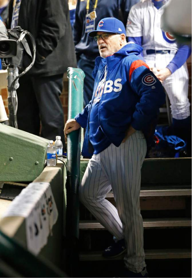 Chicago Cubs manager Joe Maddon waits before Game 6 of the National League baseball championship series against the Los Angeles Dodgers, Saturday, Oct. 22, 2016, in Chicago. (AP Photo/Nam Y. Huh)