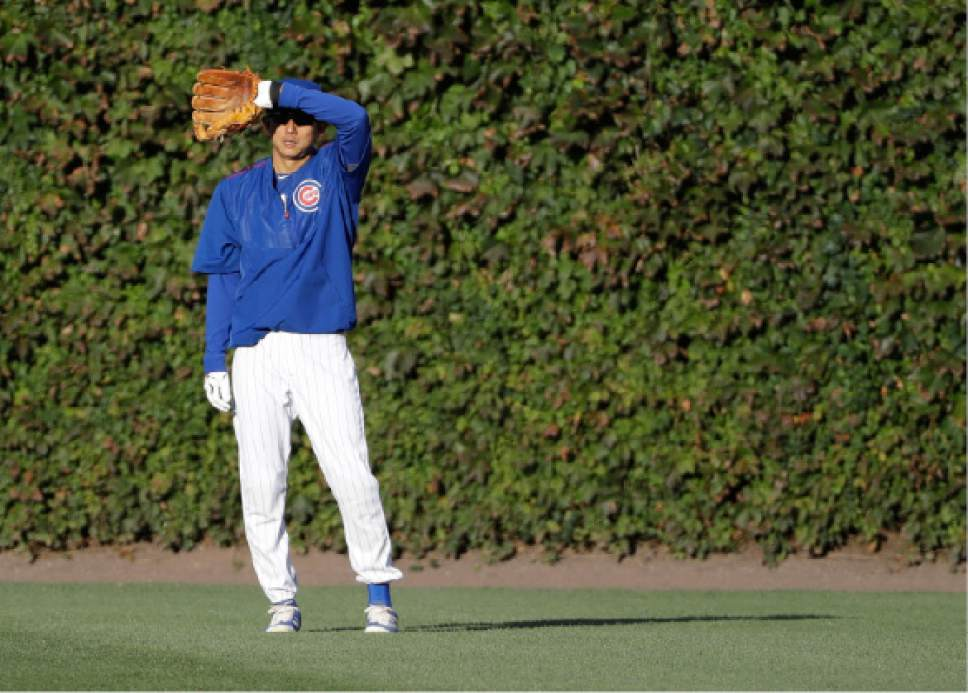 Chicago Cubs' Munenori Kawasaki warms up before Game 6 of the National League baseball championship series against the Los Angeles Dodgers, Saturday, Oct. 22, 2016, in Chicago. (AP Photo/David J. Phillip)