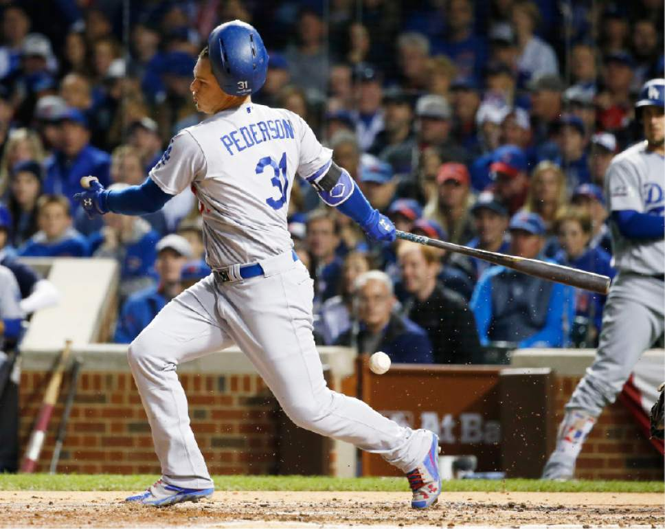 Los Angeles Dodgers center fielder Joc Pederson (31) loses his helmet as he swings strike during the second inning of Game 6 of the National League baseball championship series against the Chicago Cubs, Saturday, Oct. 22, 2016, in Chicago. (AP Photo/Nam Y. Huh)